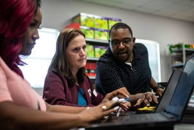 Teachers Debra Jenkins (left), Fawn Simpson and Antonio Redmon plan for six weeks of teaching and learning in a process called unit mapping.